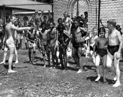 "The original handwritten caption to this photo: ""Negroes at Fairground Swimming Pool."""